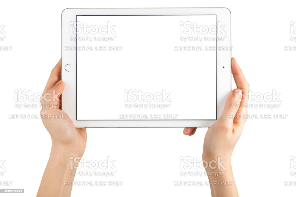 Hands Holding Touch Screen Apple iPad Air2 stock photo