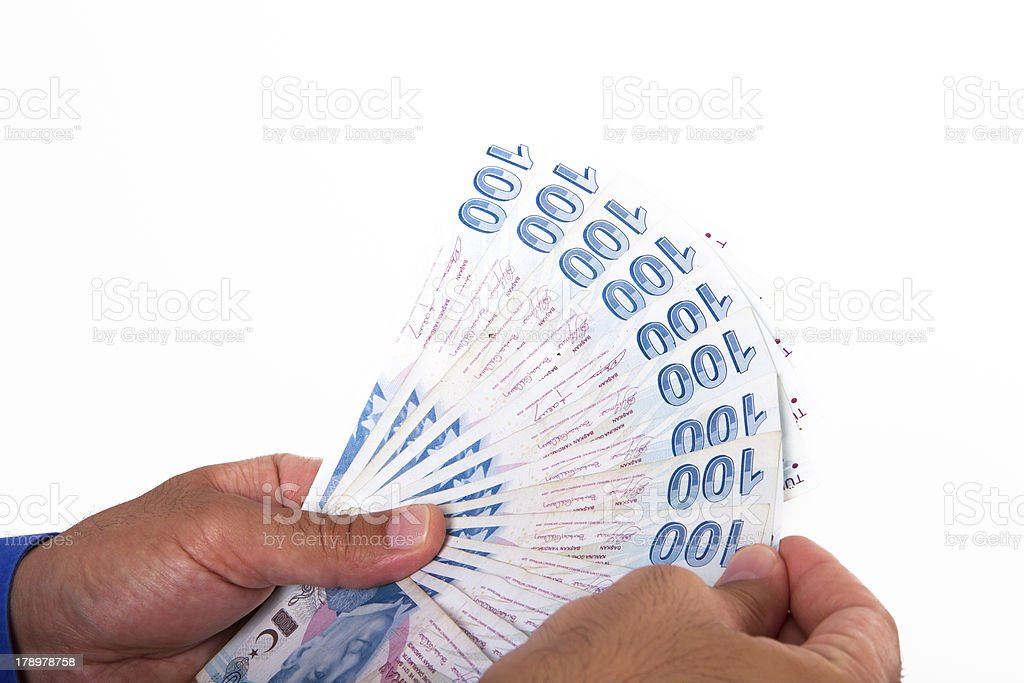 Hands Holding Turkish Lira Banknotes royalty-free stock photo