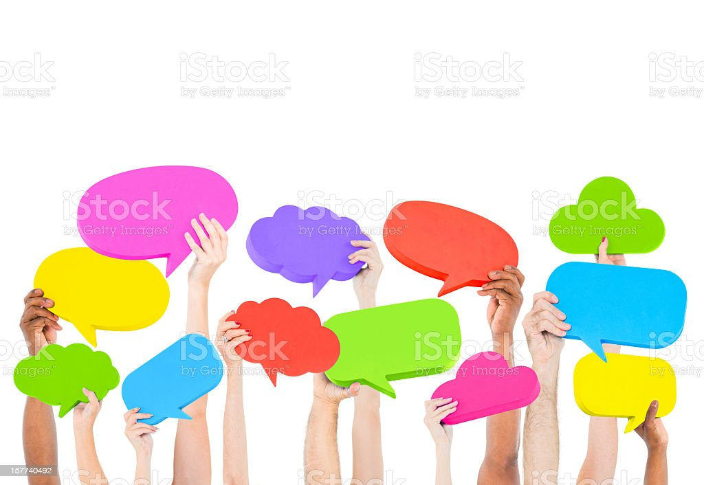 Hands holding up speech bubbles of various colors royalty-free stock photo