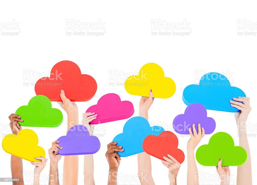 Hands holding various colors of clouds on white background royalty-free stock photo