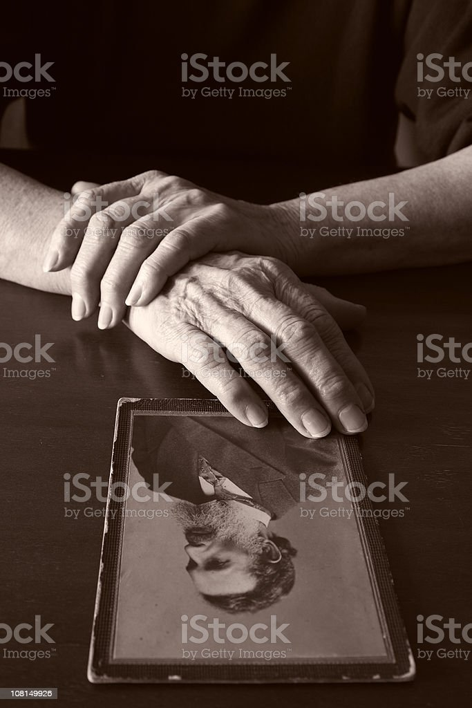 Hands Holding Vintage Photograph, Black and White royalty-free stock photo