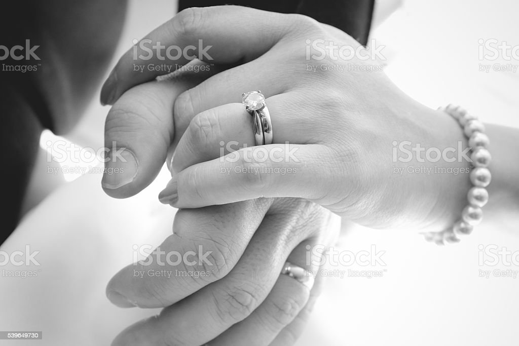 Hands holding with wedding rings stock photo