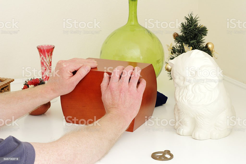 Hands Holding Wood Urn stock photo