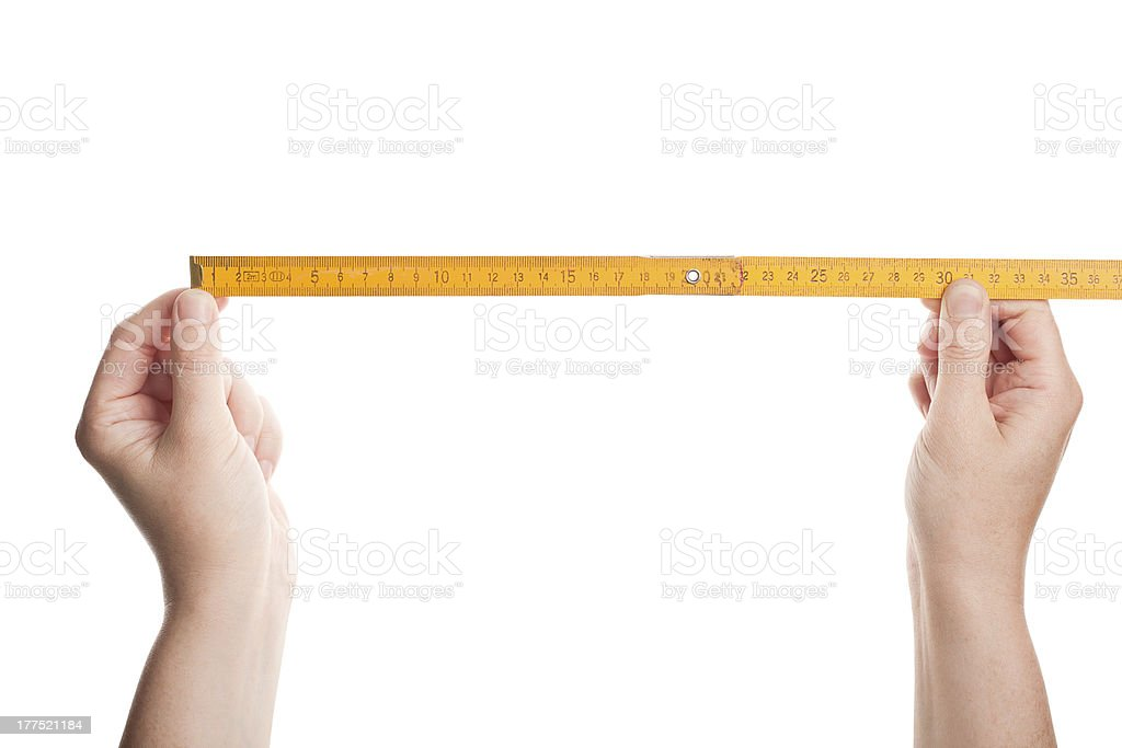 Hands holding wooden folding  ruler stock photo