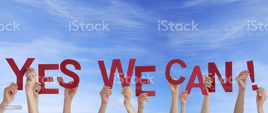 Hands Holding Yes We Can in the Sky stock photo