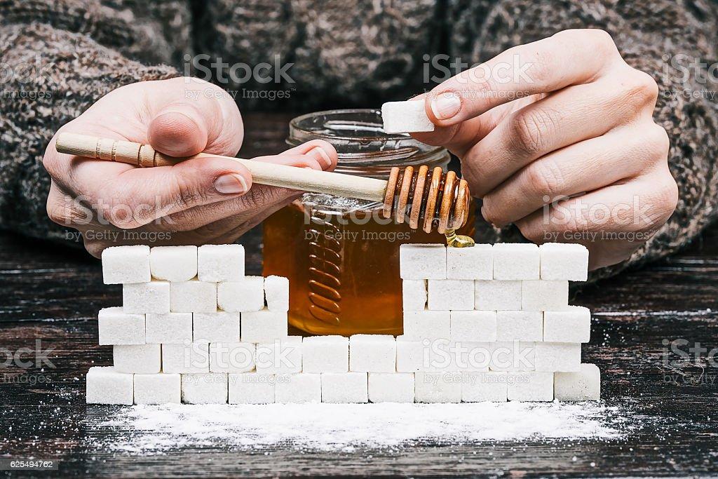 Hands, honey and sugar wall stock photo