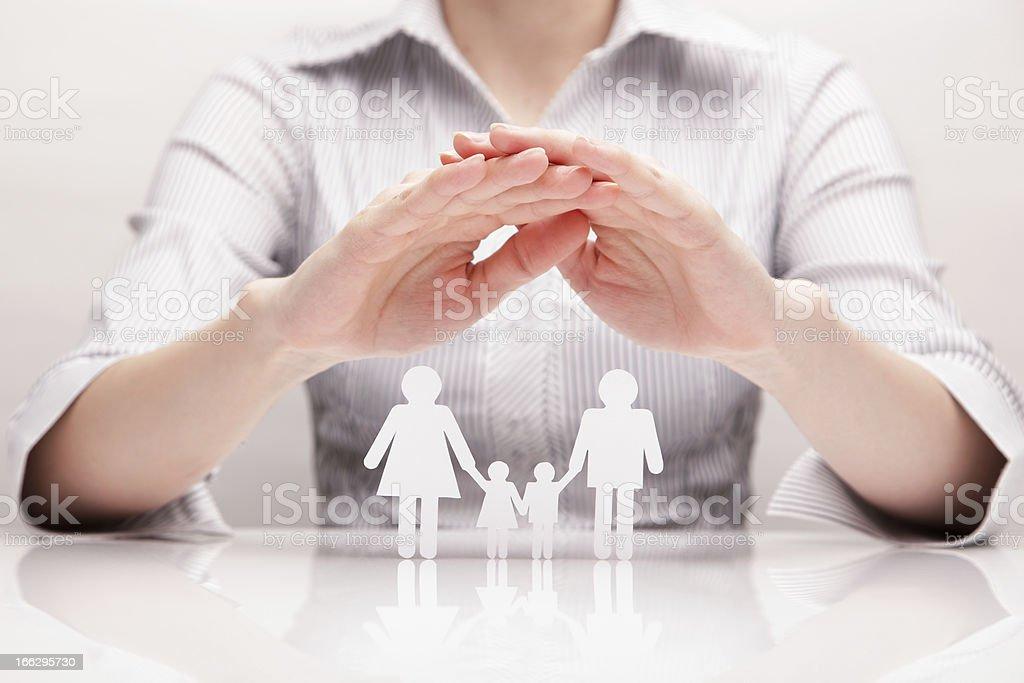 Hands hug the family stock photo