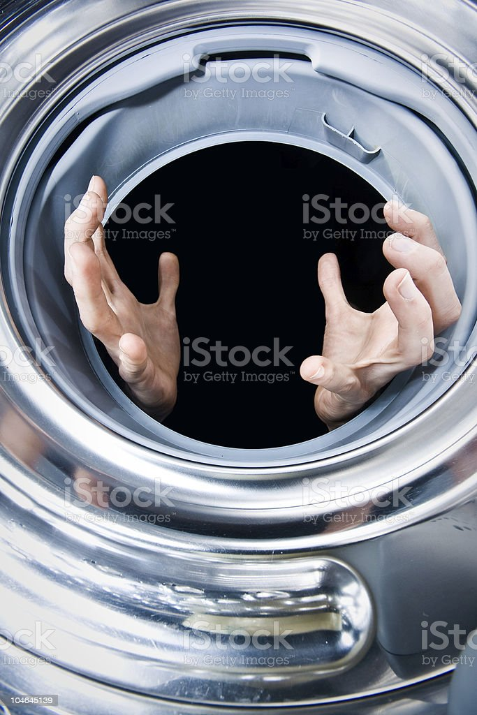 Hands in a washing machine royalty-free stock photo