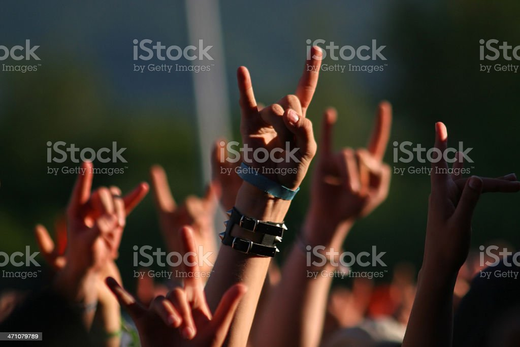 Hands in air at concert making rock sign gesture stock photo