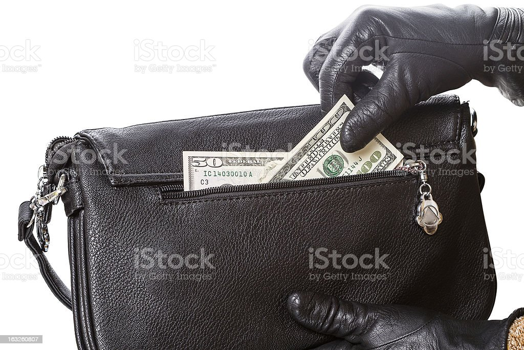 Hands in black gloves and dollars royalty-free stock photo