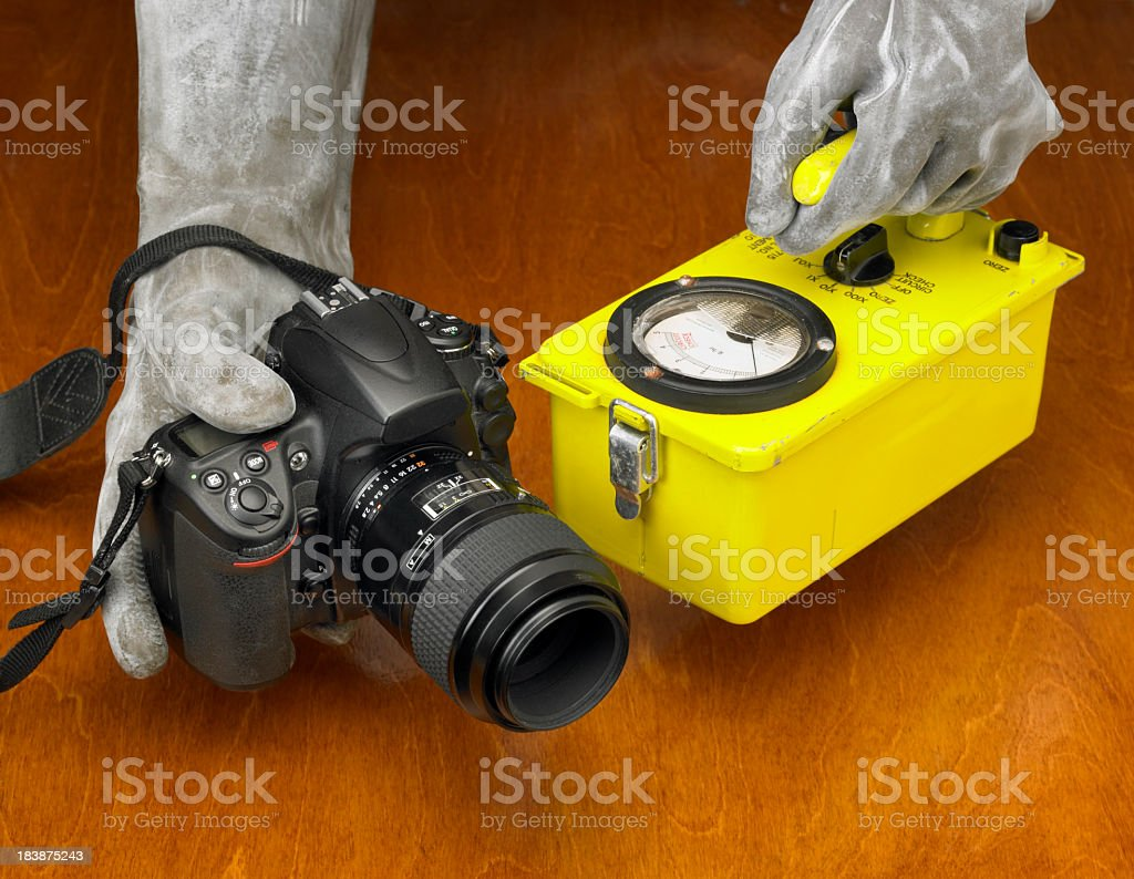 Hands in gloves checking a camera for radiation stock photo