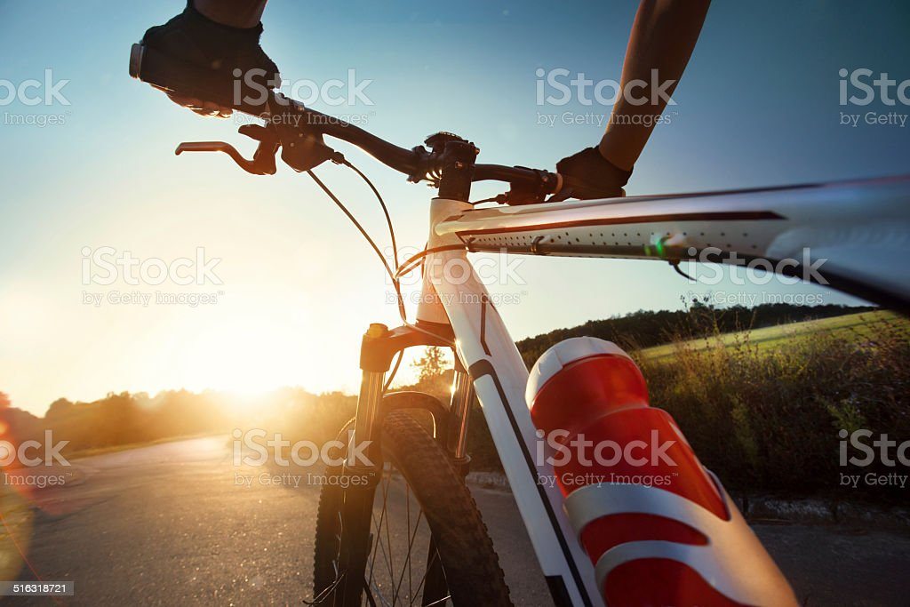 Hands in gloves holding handlebar of a bicycle stock photo