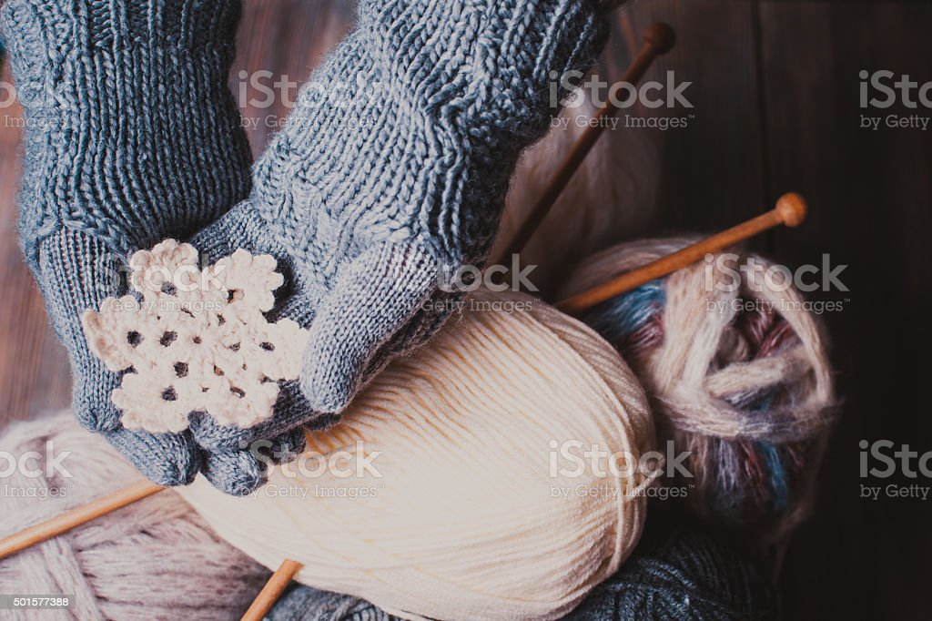 Hands in knitted gloves stock photo