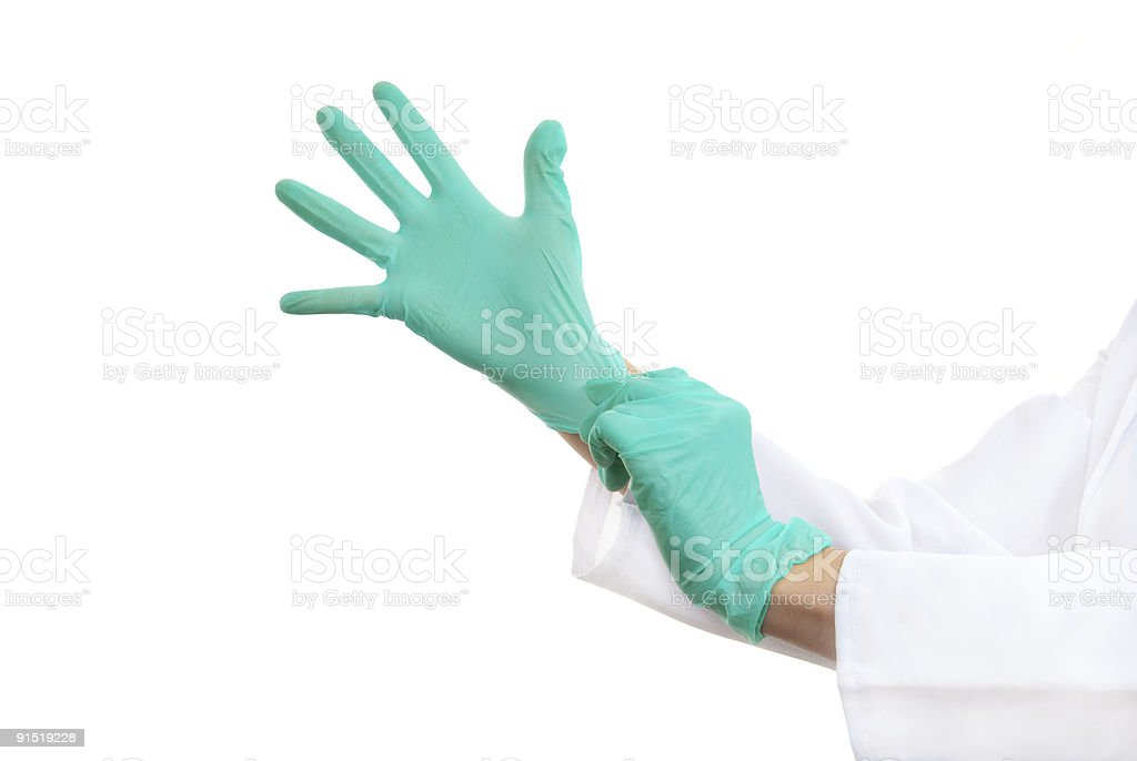 Hands in surgical gloves royalty-free stock photo