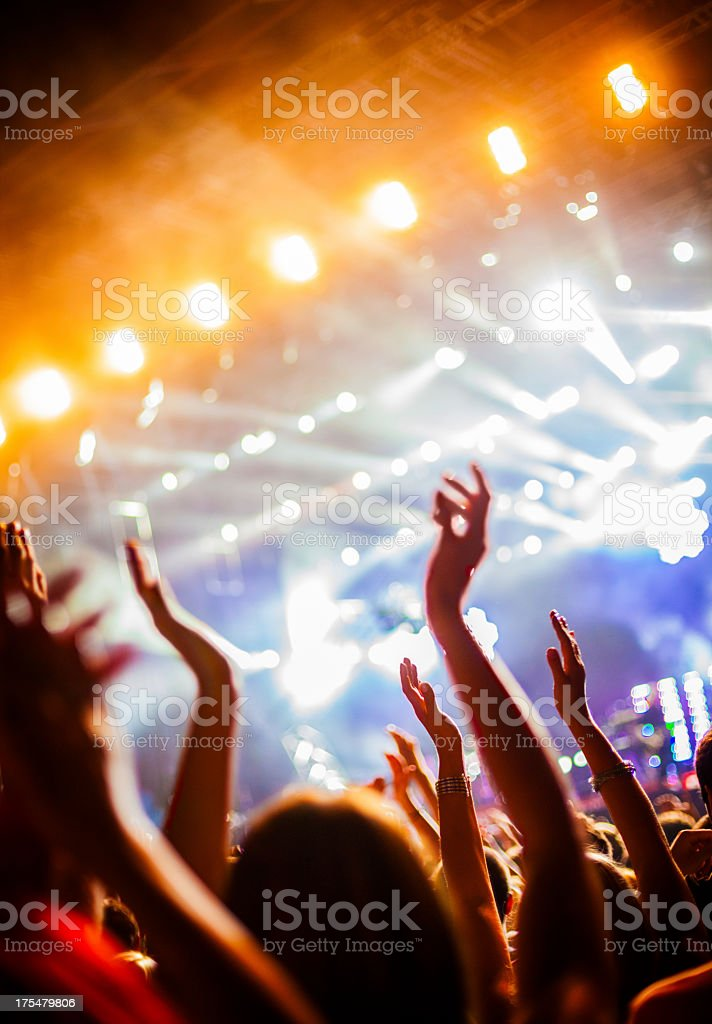 Hands in the air at a concert party atmosphere stock photo