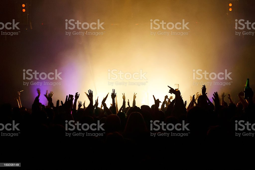 Hands in the air at a music concert stock photo