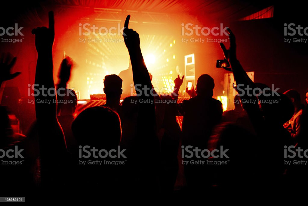 Hands in the air silhouette at nightclub party rave stock photo