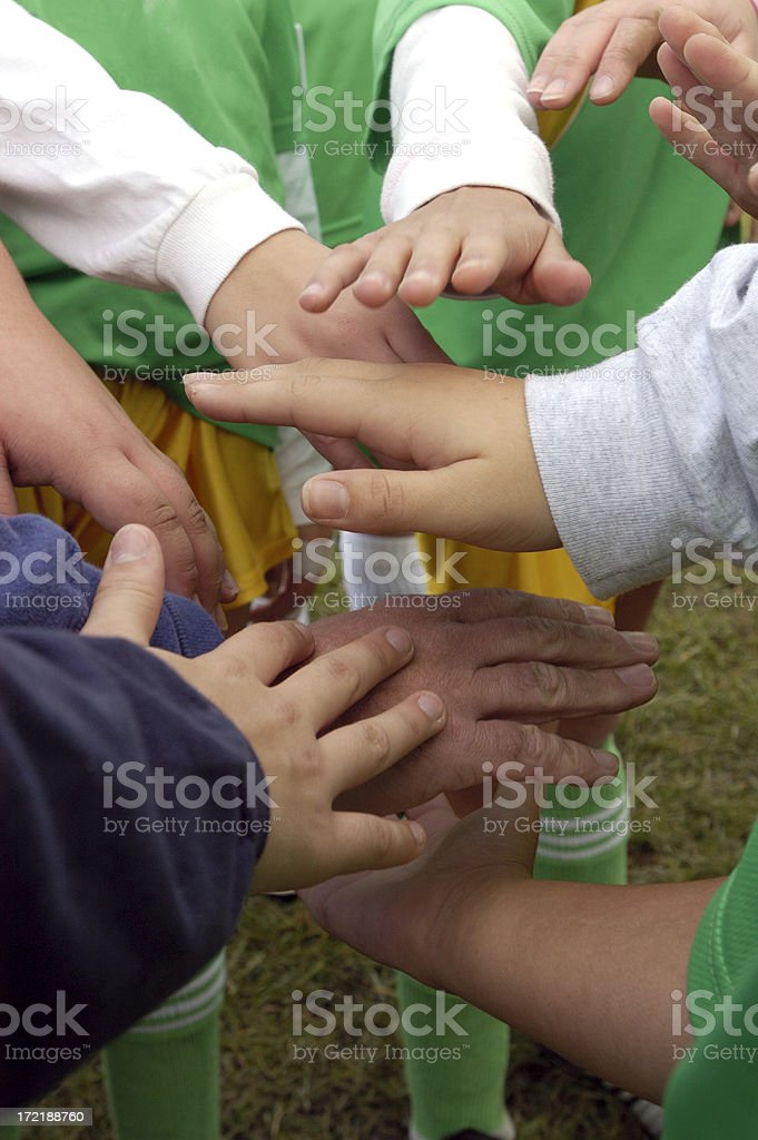 hands in the huddle royalty-free stock photo