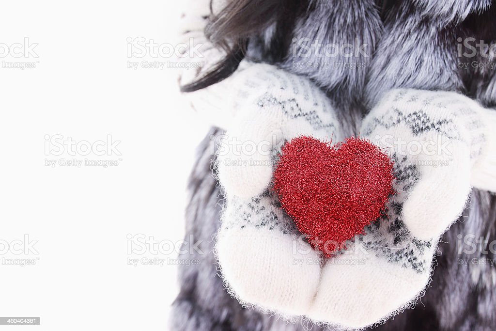 hands in woolen mittens stock photo