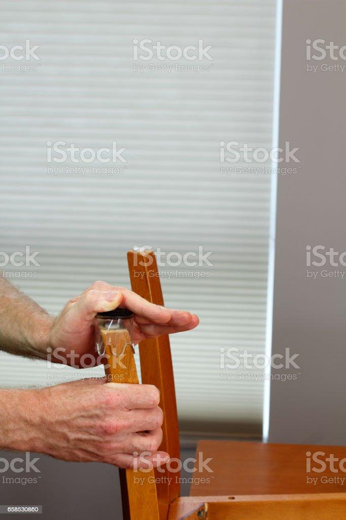 Hands Installing Clear Floor Protectors stock photo