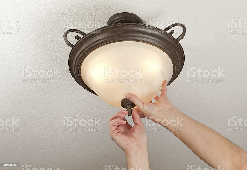 Hands Installing Glass Light Fixture Dome stock photo