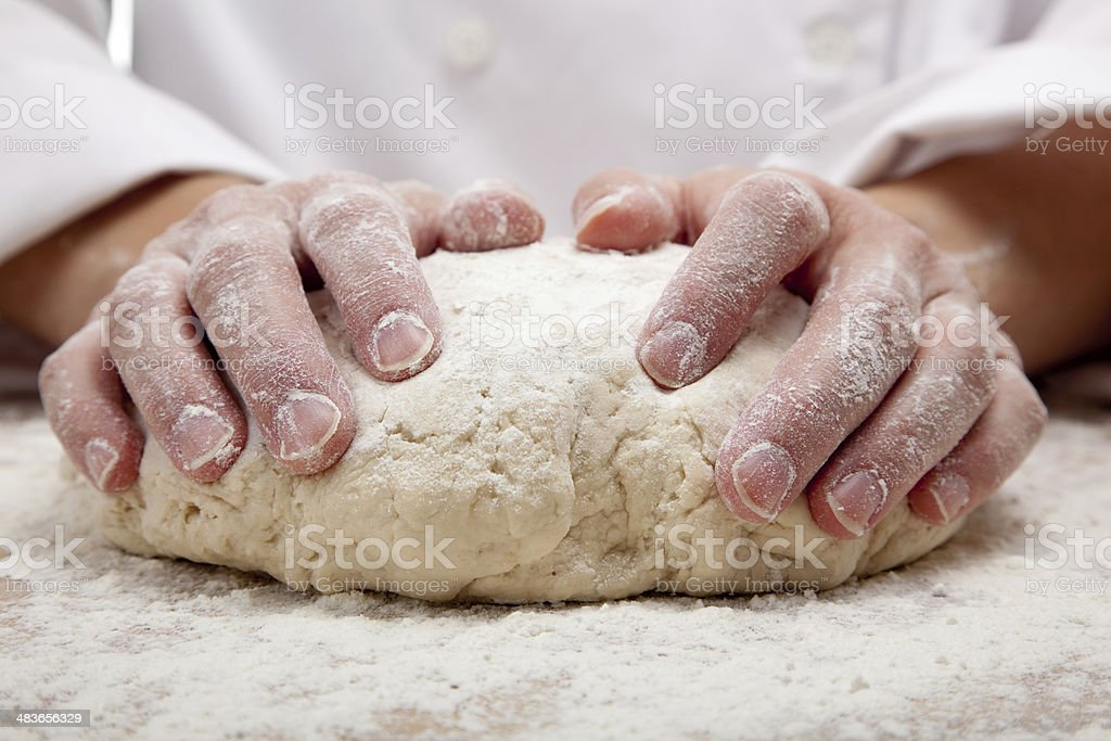 hands kneading bread dough royalty-free stock photo