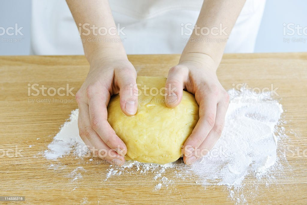 Hands kneading dough royalty-free stock photo