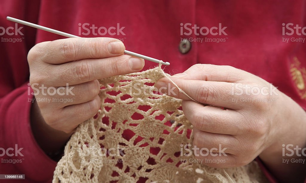 Hands, knitting by a hook royalty-free stock photo
