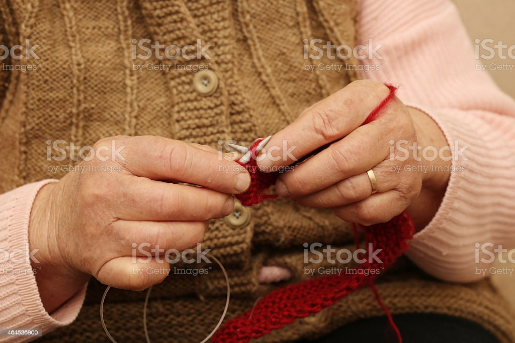 Hands knitting close-up stock photo