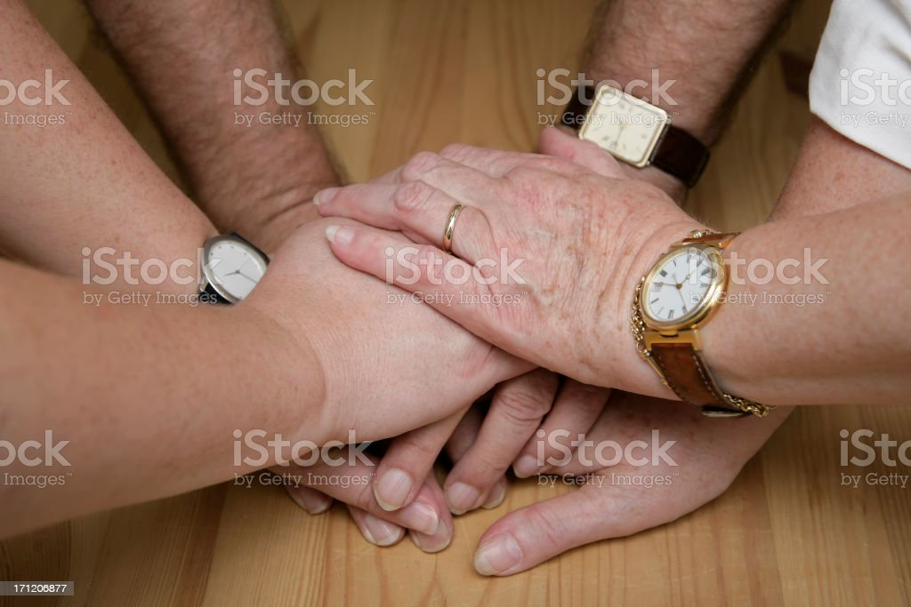 Hands liked on top of each other showing there together royalty-free stock photo