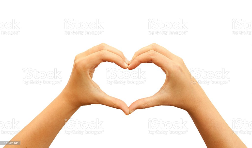 Hands making heart shape stock photo