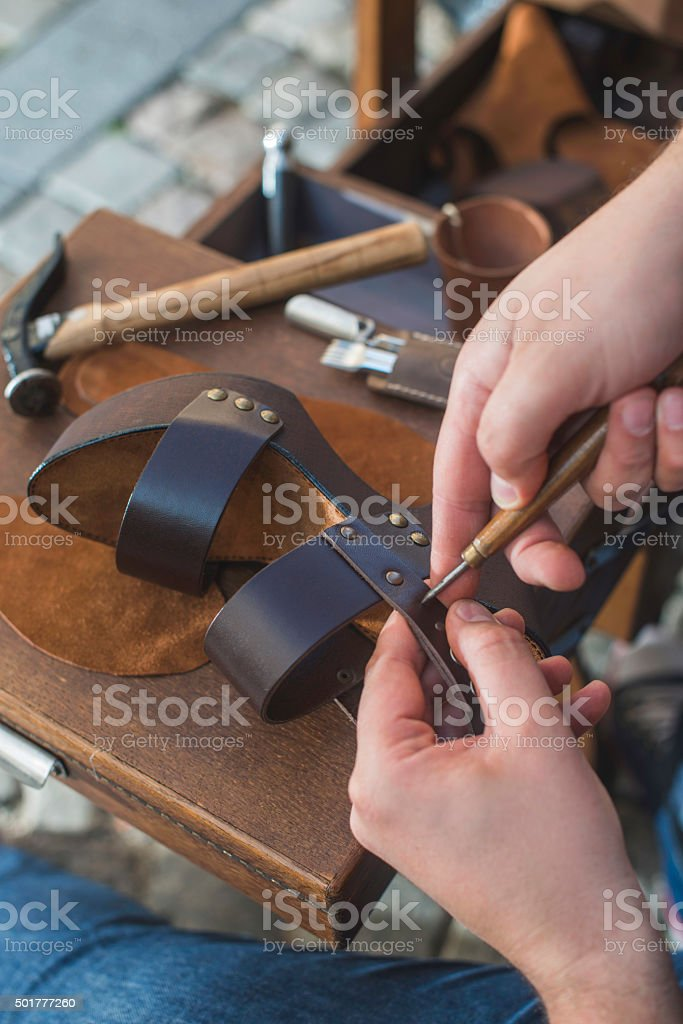 Hands making shoes stock photo