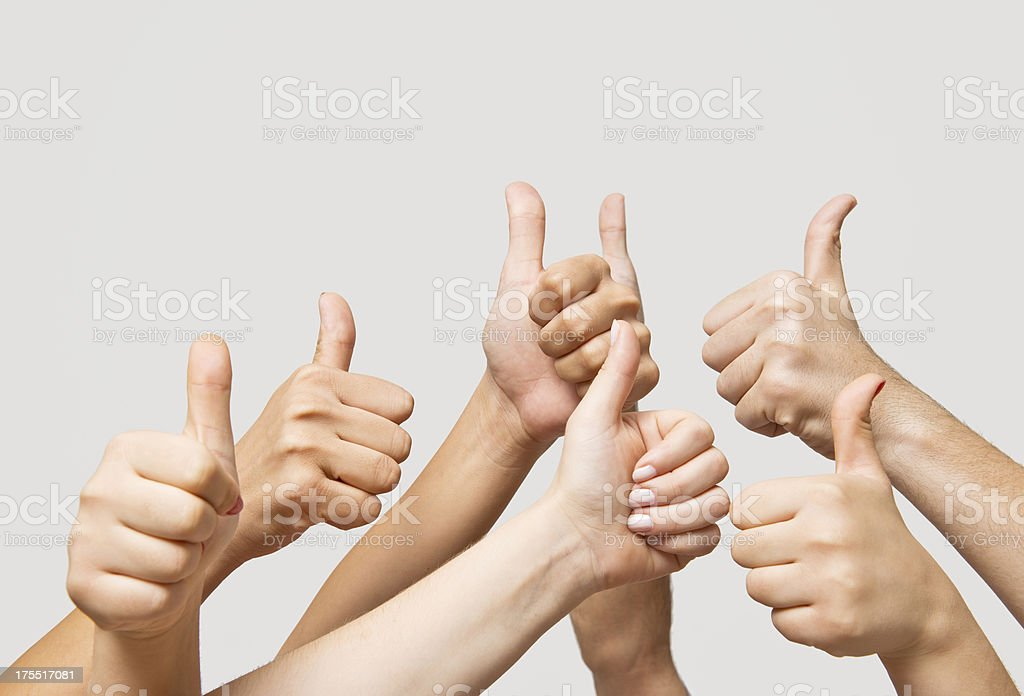 Hands making thumbs up royalty-free stock photo