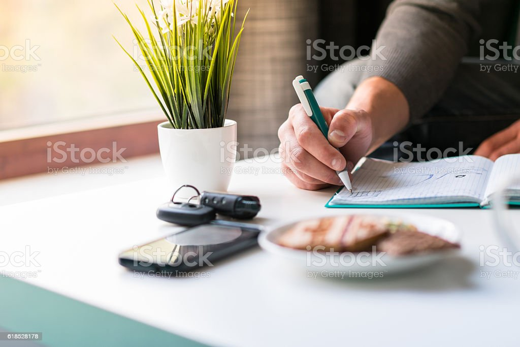 Hands male writing something stock photo