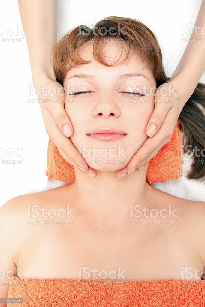 Hands massaging female face at the spa royalty-free stock photo