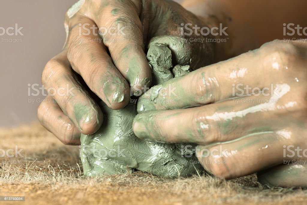 hands moulding a clay stock photo