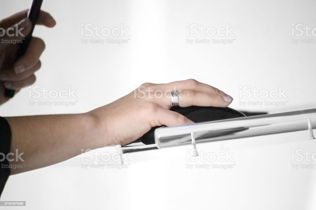 Hands moving mouse stock photo