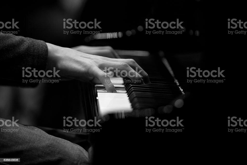 Hands musician playing the piano closeup stock photo