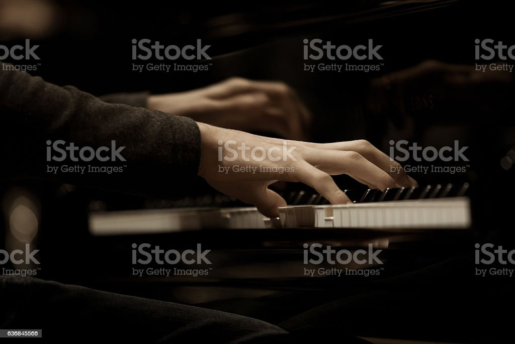 Hands musician playing the piano stock photo