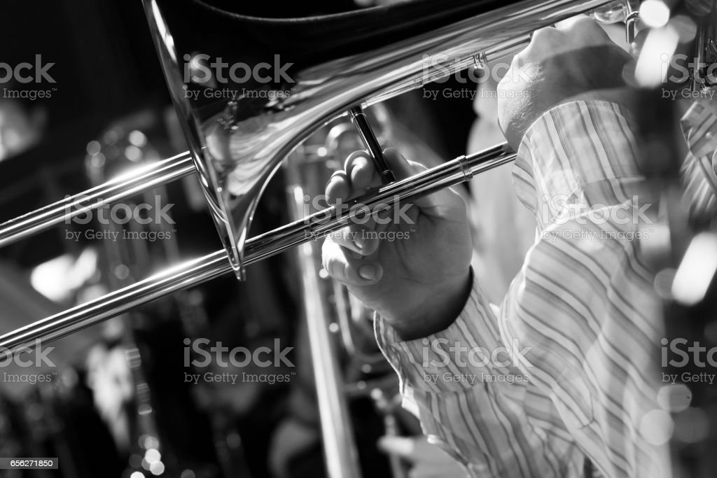 Hands musician playing the trombone stock photo