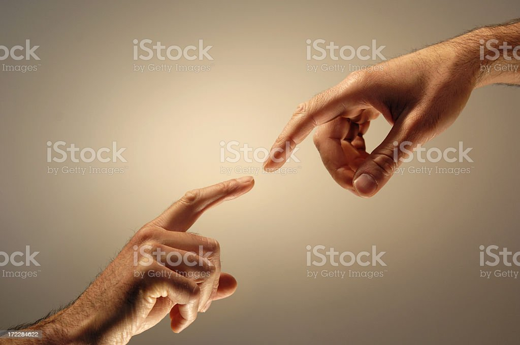 Hands Nearly Touching stock photo
