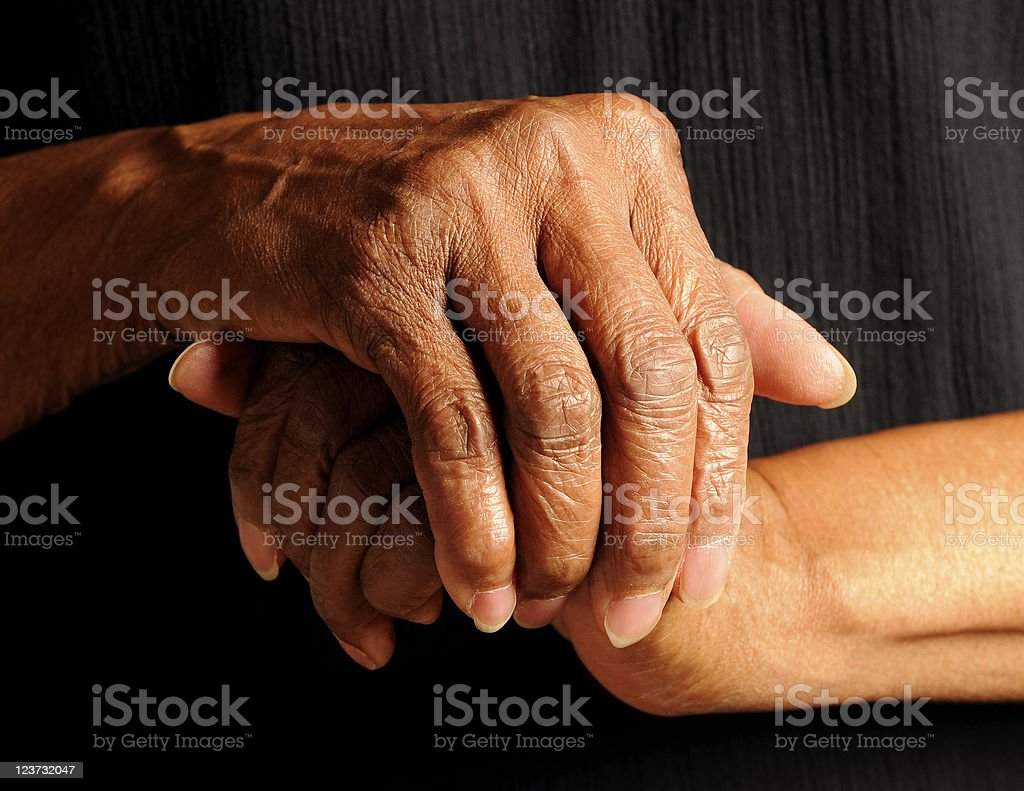 Hands of a  An African America Senior Isolated on Black royalty-free stock photo