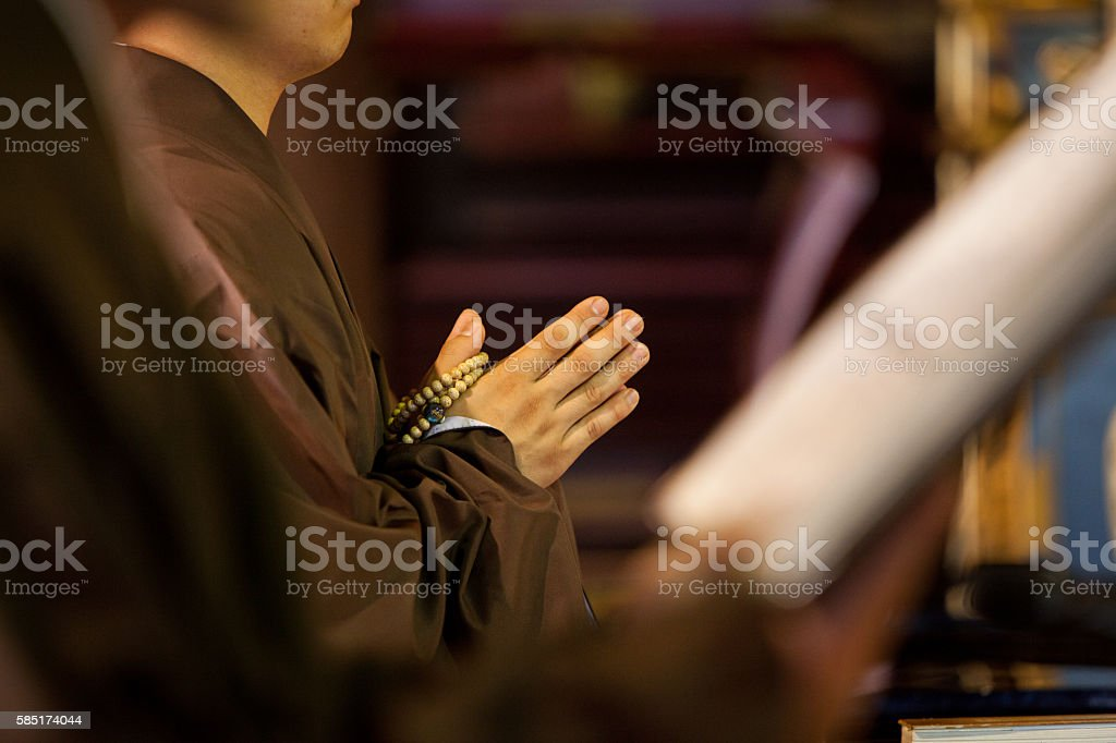 Hands of a Buddhist monk praying stock photo