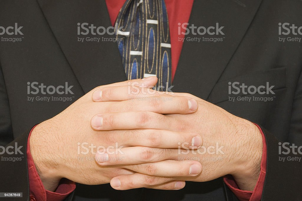 Hands of a businessman with fingers interlocked royalty-free stock photo