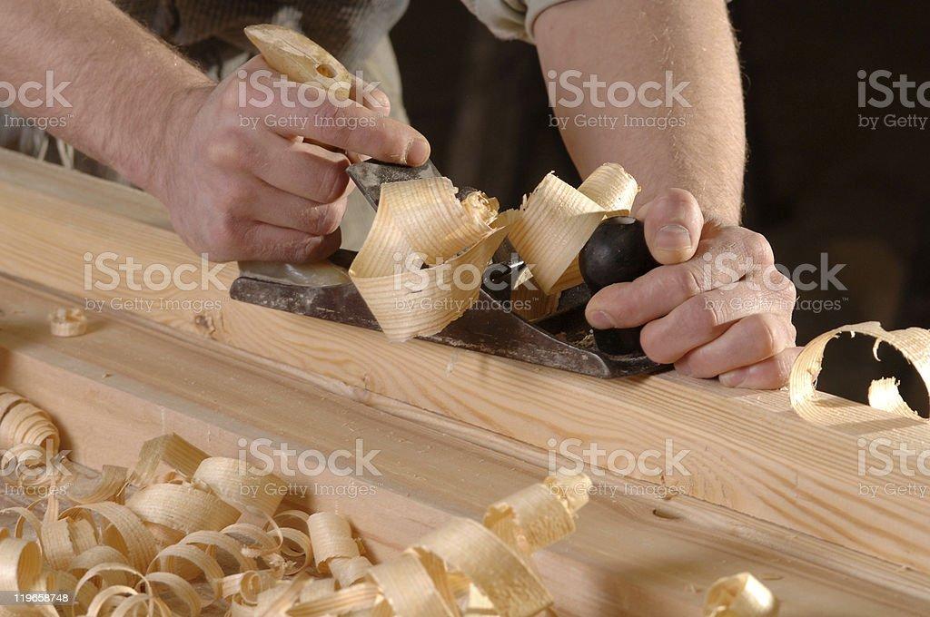 Hands of a carpenter stock photo