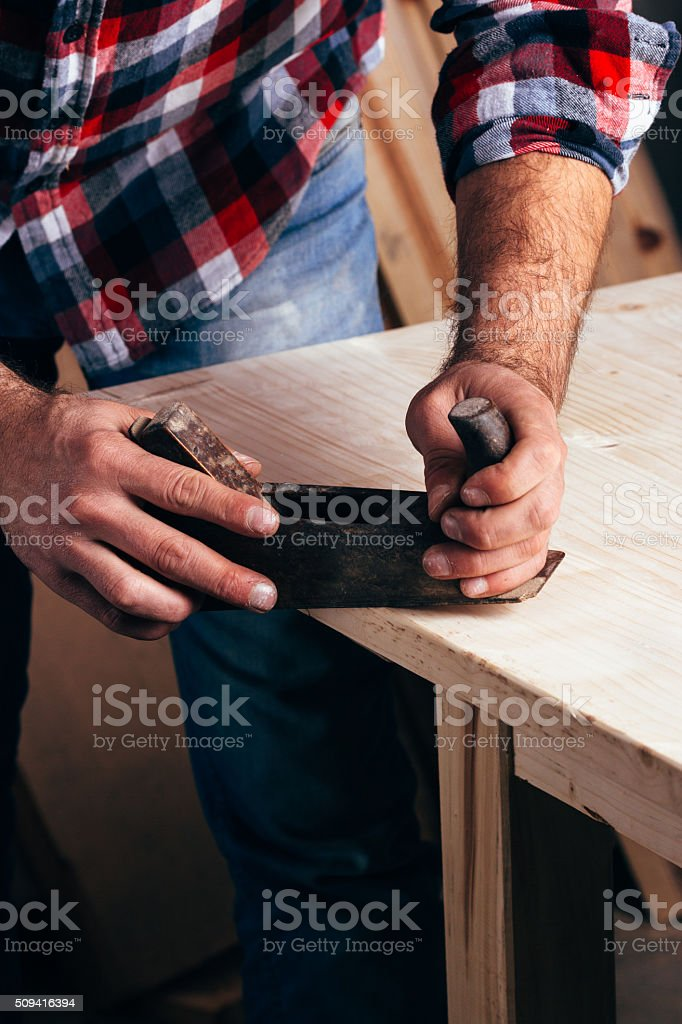 Hands of a carpenter planed wood, workplace royalty-free stock photo