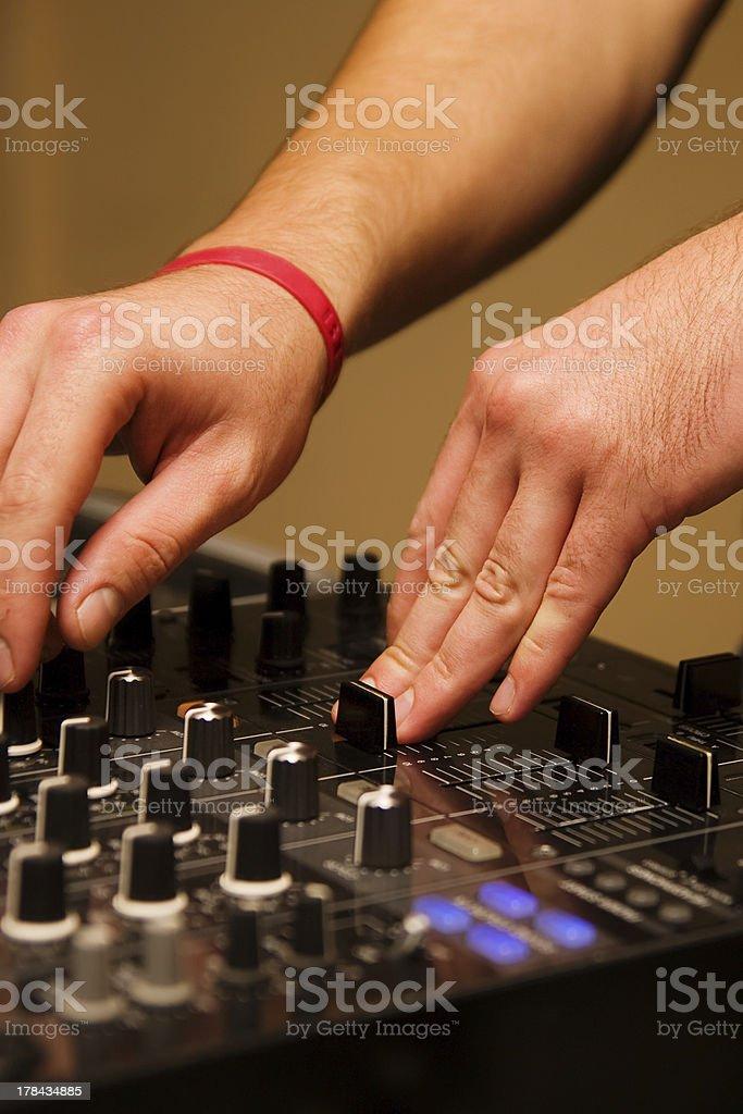 Hands of a disc jockey mixing tracks stock photo