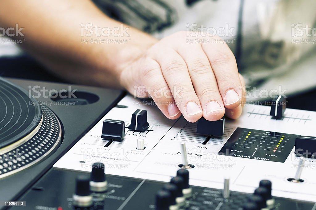 Hands of a dj adjusting the crossfader stock photo