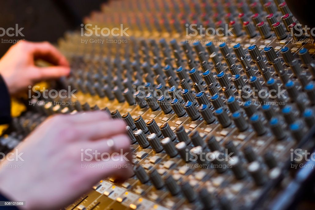 Hands of a DJ on the background, professional audio stock photo