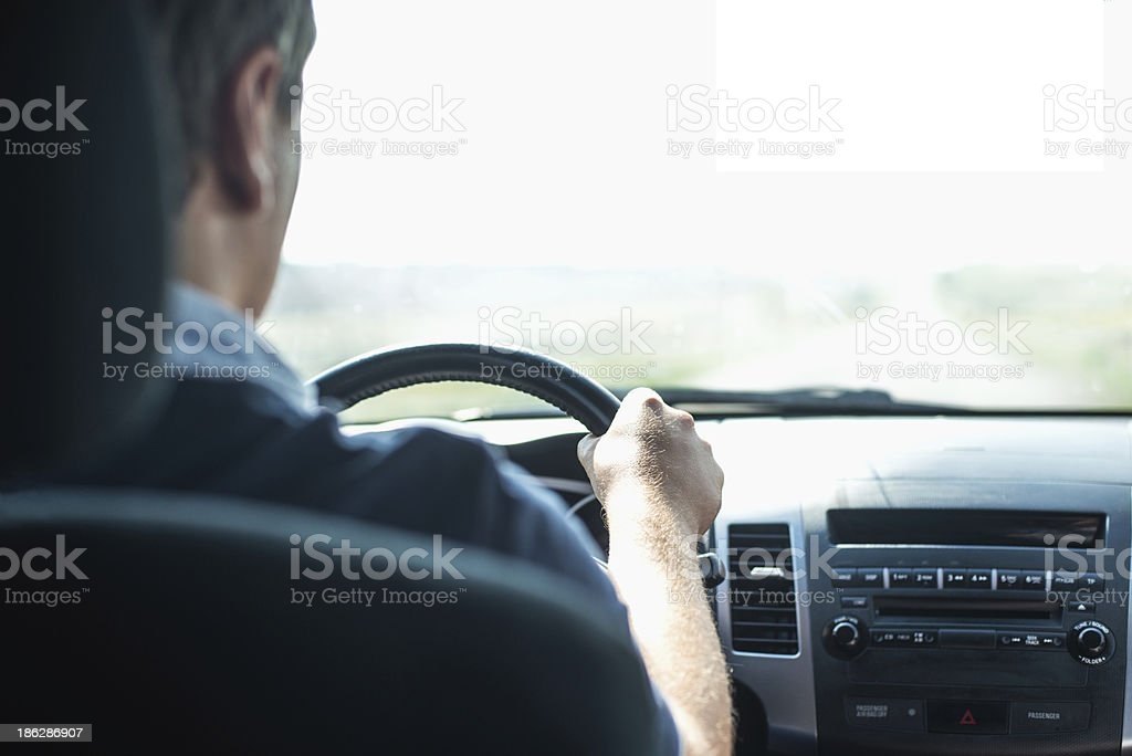 Hands of a driver on wheel stock photo